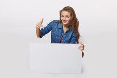 Denim style portrait of teen girl on the floor holding white bla Stock Photos
