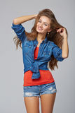 Denim style portrait of teen girl, over gray background Royalty Free Stock Photo