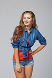 Denim style portrait of teen girl, over gray background Stock Image