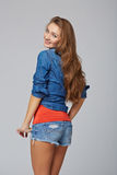 Denim style portrait of teen girl, over gray background Royalty Free Stock Image