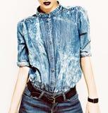 Denim stylish clothes. Glamorous lady fashion trends Stock Photography