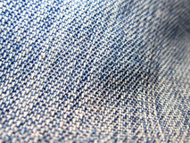 Denim Texture Background. A background of an uneven blue denim fabric Royalty Free Stock Photography