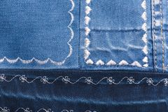 Denim texture with different patterns of white thread Stock Photo