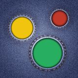 Denim texture with multicolored round holes. Stock Photo