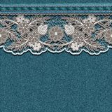 Denim texture with sewn white lace ribbon. Stock Photo