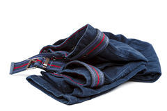 Denim trousers with a brown belt on white background. Denim trousers with a brown belt isolated on white background Stock Images