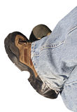 Denim and work boots. Isolated denim pant legs and work boots royalty free stock photo
