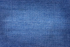 Denim worn texture. Denim with worn copy space in center. For texture and background stock images