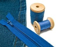 Denim with zipper and threads Stock Image