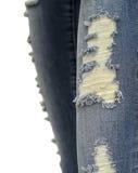 Denimbaumwollstoffrissrand-Detailhintergrund Stockbilder