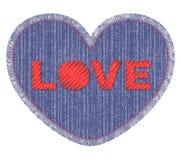 Denimflecken mit Liebesstickerei Stockbilder