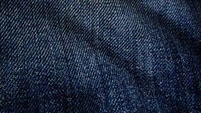 Denimstof het geweven blauwe fladderen Geanimeerde beweging van het canvas De golven van het materiaal royalty-vrije illustratie
