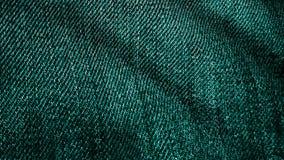 Denimstof het geweven groene fladderen Geanimeerde beweging van het canvas De golven van het materiaal vector illustratie