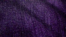 Denimstof het geweven violette fladderen Geanimeerde beweging van het canvas De golven van het materiaal royalty-vrije illustratie