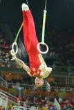 Denis Abliazin av rysk federation konkurrerar på cirklarna för man` som s är sista på konstnärlig gymnastikkonkurrens på Rio de J royaltyfria bilder