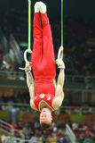 Denis Abliazin of Russian Federation competes at the Men`s Rings Final on artistic gymnastics competition at Rio 2016 Olympic Game Stock Photography