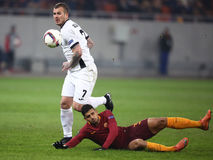 Denis Alibec and Emerson Palmieri. Denis Alibec, player of Astra Giurgiu and Emerson Palmieri dos Santos, player of AS Roma pictured during the Europa League Stock Images