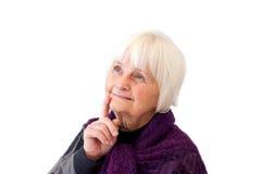 Denken - nettes Schauen der älteren Frau Lizenzfreies Stockfoto