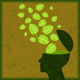 Denken Sie Grünabwehr-Erdblätter und menschliches Gehirn Stockfoto