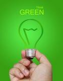 Denken Sie grünes Konzept stockbilder