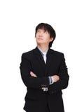 Denkende Aziatische die zakenman, op witte achtergrond wordt geïsoleerd Royalty-vrije Stock Foto