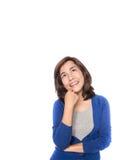 Denkende bedrijfsvrouw die omhoog kijkt Royalty-vrije Stock Afbeeldingen