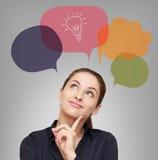 Denkende bedrijfsvrouw met idee Stock Afbeelding