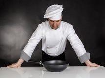 Denkende chef-kok Stock Foto