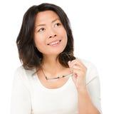 Denkende fällige asiatische Frau Lizenzfreie Stockbilder