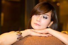 Denkende Frau Stockfoto