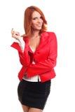 Denkende Frau im Rot Stockfotos