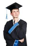 Denkende gediplomeerde student royalty-vrije stock afbeeldingen
