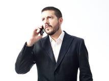 Denkende jonge zakenman op de telefoon Stock Afbeelding