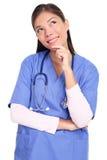 Denkende Krankenschwester getrennt lizenzfreie stockbilder