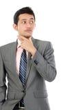 Denkender junger Geschäftsmann Stockfoto