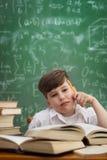 Denkender Schüler stockbild