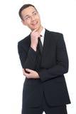 Denkender und lächelnder Geschäftsmann Lizenzfreie Stockfotos