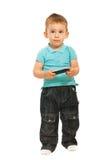 Denkendes Kleinkindholding-Mobiltelefon Stockfoto