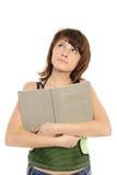 denkendes Mädchen mit dem Buch Stockfotos