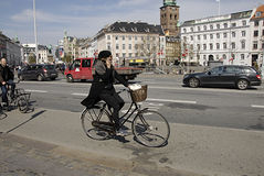 DENMARK_bicycle rider talks Royalty Free Stock Image