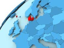 Denmark on blue globe. Denmark in red on blue model of political globe. 3D illustration Stock Images
