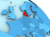 Denmark on blue globe. Denmark highlighted on blue 3D model of political globe. 3D illustration Royalty Free Stock Photos