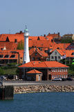 Denmark Bornholm Island Port of Ronne. Denmark, Bornholm Island, Rooftops and lighthouse of Ronne viewed from port entrance stock images