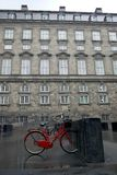 Denmark: Christiansborg Palace red bicycle Royalty Free Stock Photo