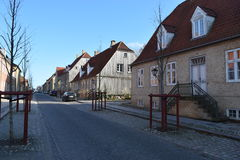 2015. Denmark. Christiansfeld. UNESCO. Traditional houses. The photo shows, the main street of Christiansfeld, with its typical type of houses made in yellow stock photos