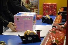 DENMARK_christmas shoppers. Copenhagen /Denmark-  22  December  2013   _Christmas shopperw tih shopping carts and wraping their christmas presents at shopping Royalty Free Stock Photography