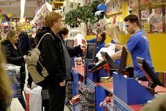 DENMARK_christmas shoppers. Copenhagen /Denmark-  22  December  2013   _Christmas shopperw tih shopping carts and wraping their christmas presents at shopping Stock Photo