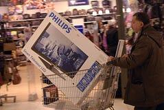 DENMARK_christmas shoppers. Copenhagen /Denmark-  22  December  2013   _Christmas shopperw tih shopping carts and wraping their christmas presents at shopping Stock Photos