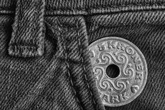 Denmark coin denomination is 5 krone crown in the pocket of old denim jeans, monochrome shot. Denmark coin denomination is five krone crown in the pocket of old Stock Photo