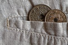 Denmark coin denomination is 2 and five krone crown in the pocket of worn linen pants. Denmark coin denomination is two and five krone crown in the pocket of Stock Photo